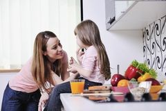 Happy daughter and mom in kitchen Royalty Free Stock Photos