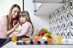 Happy daughter and mom in kitchen Royalty Free Stock Photo