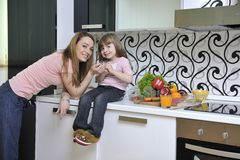 Happy daughter and mom in kitchen Royalty Free Stock Photography