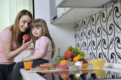 Happy daughter and mom in kitchen Royalty Free Stock Image