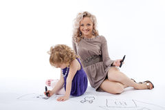 Happy daughter and mother draw Royalty Free Stock Photos