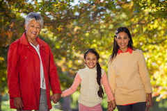 Happy daughter with mother and grandmother at park Stock Photo