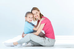 Happy daughter and mother hugging each other Royalty Free Stock Images