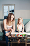 Happy Daughter and Mother Painting Stock Images