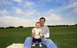 Happy Day. Father and son enjoying a day at the park royalty free stock images