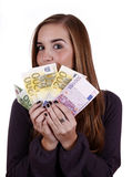 Happy day. Woman smiling and showing a large amount of money Royalty Free Stock Photography