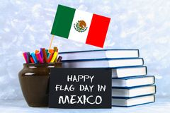 Happy day of the flag of Mexico. Books with the flag of Mexico. Happy day of the flag of Mexico. Books with the flag of Mexico royalty free stock photo