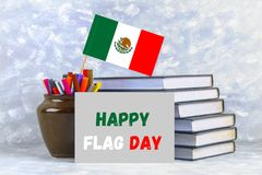 Happy day of the flag of Mexico. Books with the flag of Mexico. Happy day of the flag of Mexico. Books with the flag of Mexico stock images