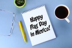 Happy day of the flag of Mexico. Text in notebook, coffee, pen, glasses, plant. Happy day of the flag of Mexico. Text in notebook, coffee, pen, glasses, plant stock images