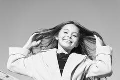 Happy day. Kid girl long hair enjoy walk sunny day blue sky background. Girl carefree childhood walk. Charming little royalty free stock photos