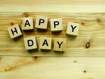 Happy day wooden block alphabet on wooden background. Top view of happy day wooden block alphabet on wooden background royalty free stock photography