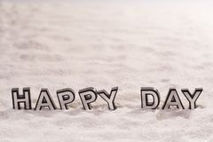 Happy day word on white sand Royalty Free Stock Photography