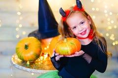 Happy deamon children during Halloween party Stock Photo