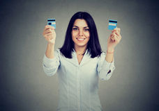 Happy debt free young woman holding a credit card cut in two pieces Stock Photography