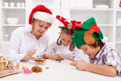 Happy decorating gingerbread cookies Royalty Free Stock Photo