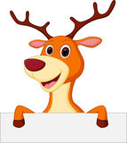 Happy deer cartoon with blank sign Royalty Free Stock Photo