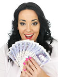 Happy Delighted Attractive Young Woman Holding Money Royalty Free Stock Photos