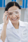 Happy delighted chemist wearing a labcoat Royalty Free Stock Photo