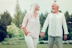 Happy delighted couple having a great time together royalty free stock image
