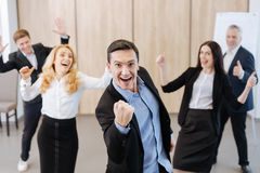Happy delighted man showing a clenched fist Royalty Free Stock Photo