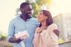 Happy delighted woman looking at her boyfriend. Thank you. Happy positive delighted women looking at her boyfriend and smiling while being thankful for her Stock Photography