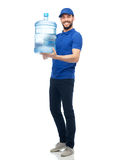 Happy delivery man with bottle of water Stock Images