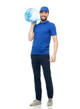 Happy delivery man with bottle of water. Delivery service and people concept - happy man or courier with bottle of water Royalty Free Stock Image