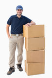 Happy delivery man with cardboard boxes Stock Photos
