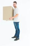 Happy delivery man carrying cardboard box Royalty Free Stock Photo