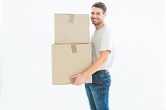 Happy delivery man carrying cardboard boxes Stock Photography