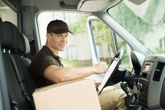 Happy Delivery Man Checking List Royalty Free Stock Photo