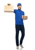 Happy delivery man with coffee and food in bag. Delivery service, fast food and people concept - happy man with coffee and disposable paper bag stock photo
