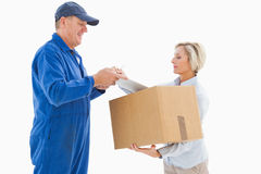Happy delivery man with customer Royalty Free Stock Photo