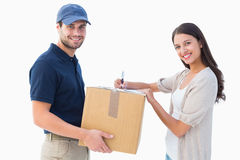 Happy delivery man with customer Royalty Free Stock Images