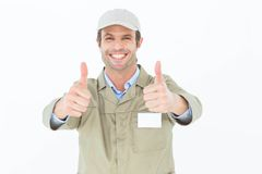 Happy delivery man gesturing thumbs up Stock Photos