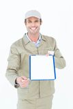 Happy delivery man giving clipboard and pen for signature Stock Photography