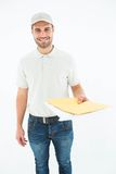 Happy delivery man giving envelops Stock Image