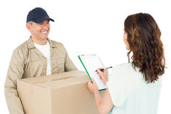 Happy delivery man giving package to customer Stock Photos