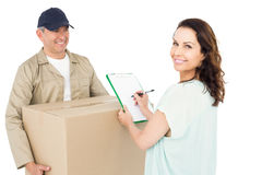 Happy delivery man giving package to customer Royalty Free Stock Images