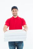 Happy delivery man giving pizza boxes Stock Images