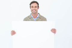 Happy delivery man holding blank billboard Stock Photo