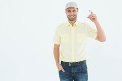 Happy delivery man holding blank card Royalty Free Stock Images