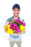 Happy delivery man holding bouquet Royalty Free Stock Photos