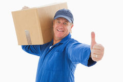 Happy delivery man holding cardboard box Royalty Free Stock Image