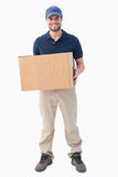 Happy delivery man holding cardboard box Stock Image