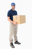 Happy delivery man holding cardboard box Royalty Free Stock Photo