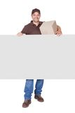 Happy Delivery Man Holding Cardbox And Placard Royalty Free Stock Photography