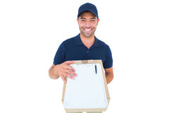 Happy delivery man with package and clipboard Royalty Free Stock Photo