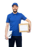 Happy delivery man with parcel box and clipboard Royalty Free Stock Photo