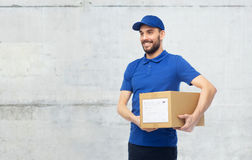 Happy delivery man with parcel box Royalty Free Stock Image